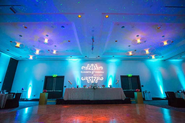 Blue wireless uplighting for a wedding reception rent online for 19