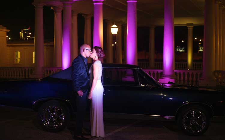 Fuschia Uplighting on Columns | Rent online for $19/each + free shipping both ways nationwide at www.RentMyWedding.com/Rent-Uplighting