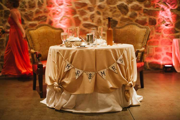 Red Uplighting Behind Sweetheart Table | Rent online for $19/each + free shipping both ways nationwide at www.RentMyWedding.com/Rent-Uplighting